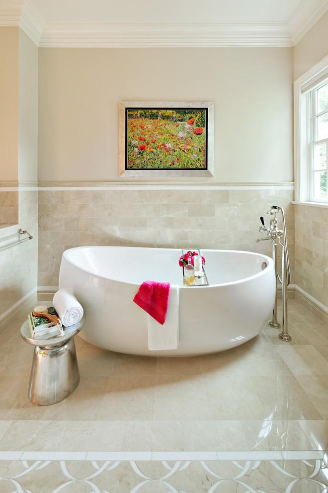 bathroom with white bath tub, silver metallic stool, nude marble floor and wall