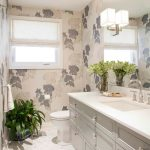 Bathroom With White Cabinet, White Toilet, White Marble Flooring, Leaves Patterned Wallpaper