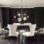 Black Dining Table White Wingback Armchairs Window Patterned Window Curtains Chandelier Table Lamps Black Walls White Wall Flowers Plate