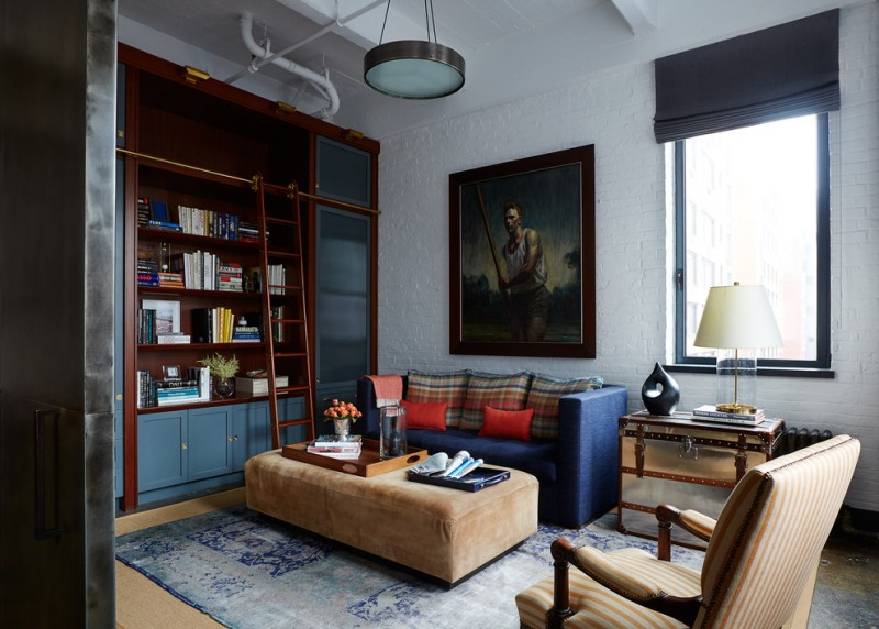bookcase with ladder and rail blue sofa brown ottoman blue cainet frosted glass door window grey shade trunk table lamp armchair blue rug