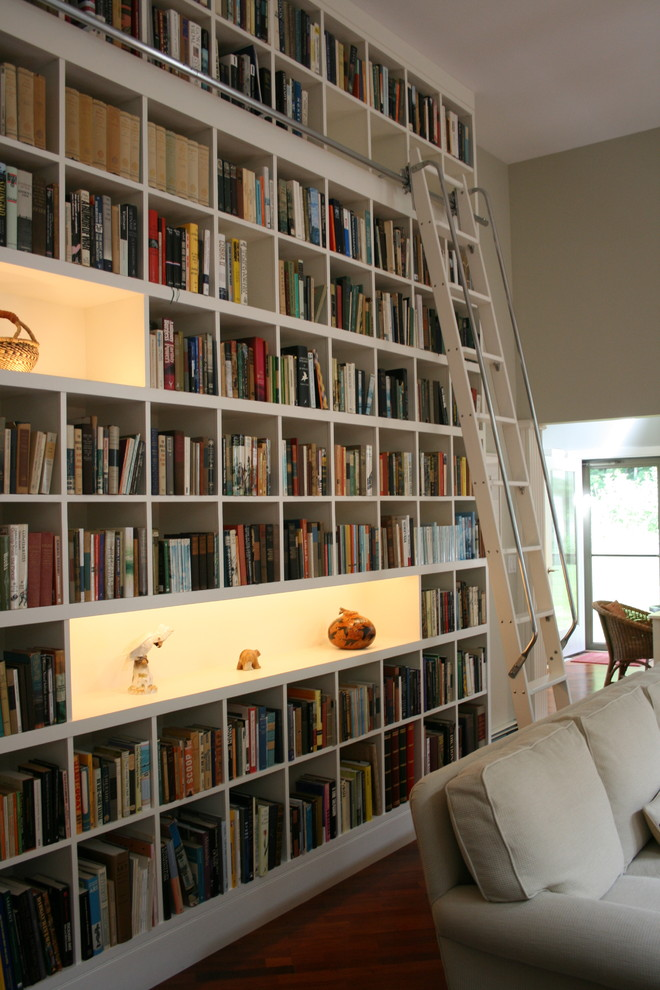 bookcase with ladder and rail display shelves grey sofa rattan chair recessed lighting white ladder wooden floor ladder railing