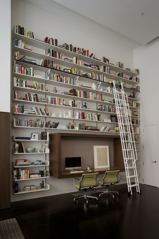 bookcase with ladder and rail green office chairs built in desk wall mounted shelves white wall area rug white ladder and railing