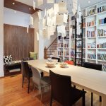 Bookcase With Ladder And Rail Wooden Dining Room Colorful Dining Chairs White Bookshelves Black Ladder Wooden Bench Wooden Floor Chandelier