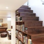 Bookshelves Inside Dark Wooden Stairs Without Hand Rails