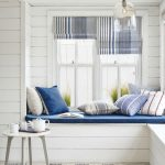Built In Reading Nook With White Wooden Wall, White Wooden Beams, White Wooden Floor, White Blue Striped Rug, White Wooden Stool