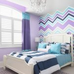 Chevron Accent Wall Crystal Chandelier White Bed White Headboard Colorful Bedding Pillows Area Rug Purple Curtain White Windows Table Lamp
