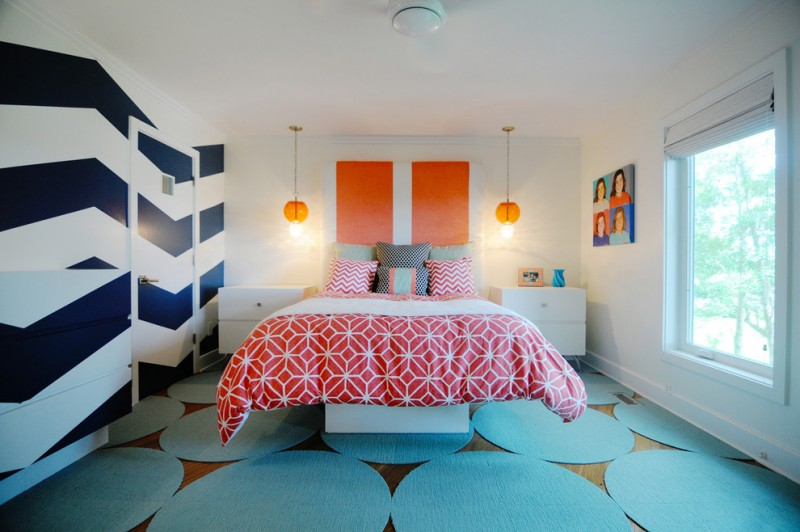 chevron accent wall floating bed red and white bedding pillows pendant lamps round blue rugs window artwork white nightstands roman shade