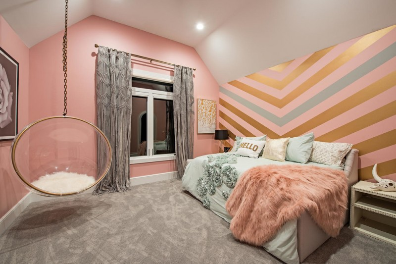 chevron accent wall pink walls black table lamp glass hanging chair grey floor nightstands windows grey curtains artwork