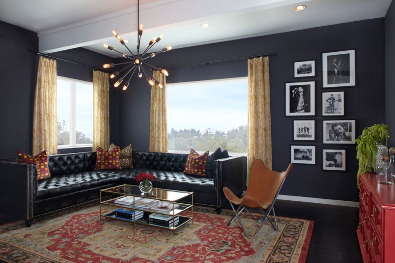 classic leather sofa chandelier black tufted sofa patterned area rug glass coffee table window curtains throw pillows brown lounge chair
