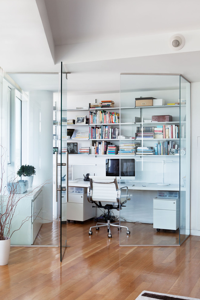 cool office desks white chair white wall mounted shelves white storage wooden floor glass walls and doors bookshelves glass windows