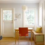 Corner Bench Seating With Storage Wooden Table Orange Chair White Pendant Lamp Colorful Throw Pillows Beige Floor White Framed Glass Windows