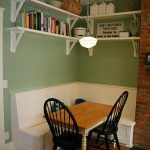 Corner Dining Set With Simple Wooden Table, Black Chairs, White Corner Bench With Pillows, White Chelves Above