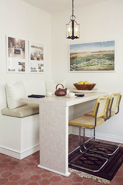 corner dining set with white square table, white bench with nude cushion, yellow metallic chair