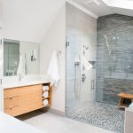 Delta Tub Shower Faucet Wooden Floating Vanity White Top Sink Grey Mosaic Wall Tile Grey Stone Floor Frameless Shower Door Tub Mirror