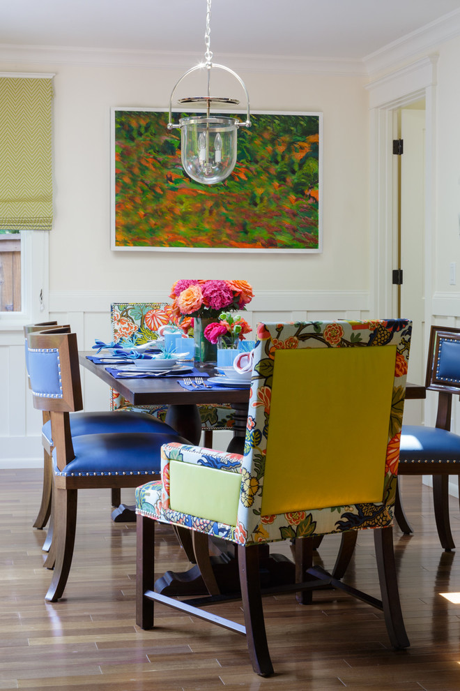 dining room with blue chairs, flower patterned chairs on the heads, wooden table