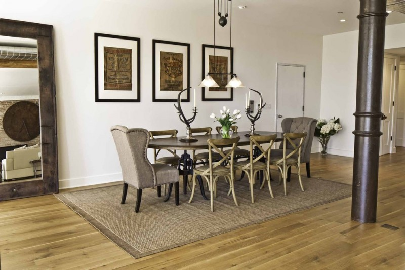 double pendant light brown area rg brown wingback armchairs wooden dining table wooden chairs artwork white wall standing mirror wooden floor