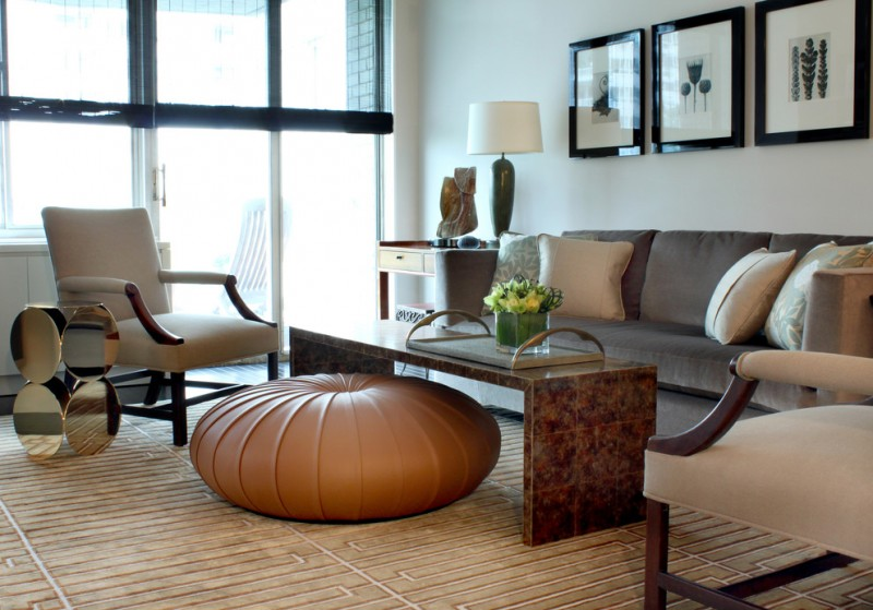 end table with drawer and shelf brown ottoman dark sofa beige armchairs coffee table textured area rug mirrored coffee table table lamp