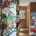 Entry With Brown Wooden Floor, Brown Wallpaper In One Side, Colorful Flowery In The Other