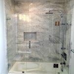 Frameless Hinged Tub Door Black Marble Wall Tle Shower Head Shower Fixture White Built In Shower White Walls Recessed Lighting