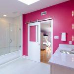 Frameless Hinged Tub Door Pink Walls Built In Tub White Barh Door Vanity Stainless Steel Sink Mirror Wall Sconces White Top