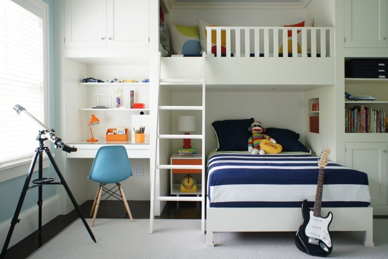 full over queen bunk bed white built in shelves white built in desk glass top nightstand table lamp blue chair cupboard white rug
