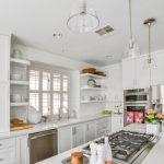 Glass Dome Pendant Light White Cabinets White Island White Countertops Stovetop Dishwasher Sink Refrigerator Oven Shelves Window