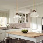 Glass Dome Pendant Light White Kitchen Cabinets White Dining Table Brown Stools Grey Floor Drawers Shelves Undermount Sink Black Countertop Window