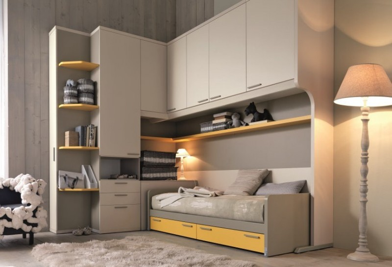 grey yellow bedroom built in cabinets grey bed yellow shelves drawers yellow drawers floor lamp shad area rug table lamp baskets chair
