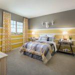 Grey Yellow Bedroom Deer Heads Grey And Yellow Walls Bedding Wooden Nightstands Table Lamps Wooden Cabinet Artwork Windows Curtains