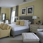 Grey Yellow Bedroom Grey Bed Tufted Headboard White Bedding Yellow Sofa Armchair Chandelier Nightstands Table Lamps Vanity Mirror Windows