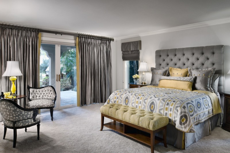 grey yellow bedroom grey tufted headboard grey and yellow bedding yellow bench grey armchairs grey curtains glass doors table lamps