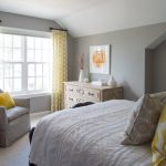 Grey Yellow Bedroom Grey Walls Yellow Curtains White Framed Glass Windows Drawers Grey Bedding Pillows Wooden Side Table Grey Armchair