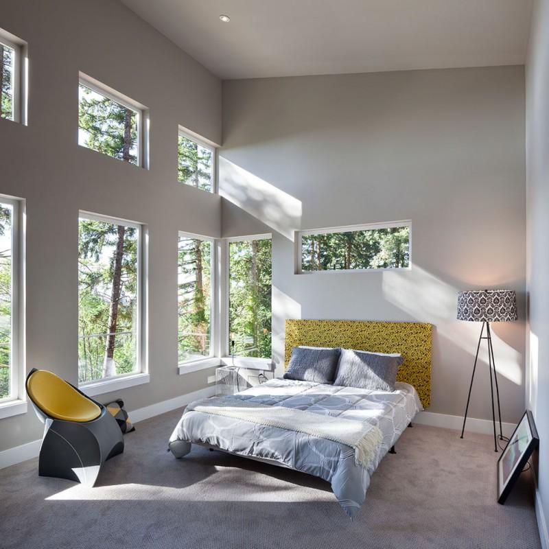 grey yellow bedroom grey walls yellow headboard floating bed unique armchair floor lamp windows nightstand windows