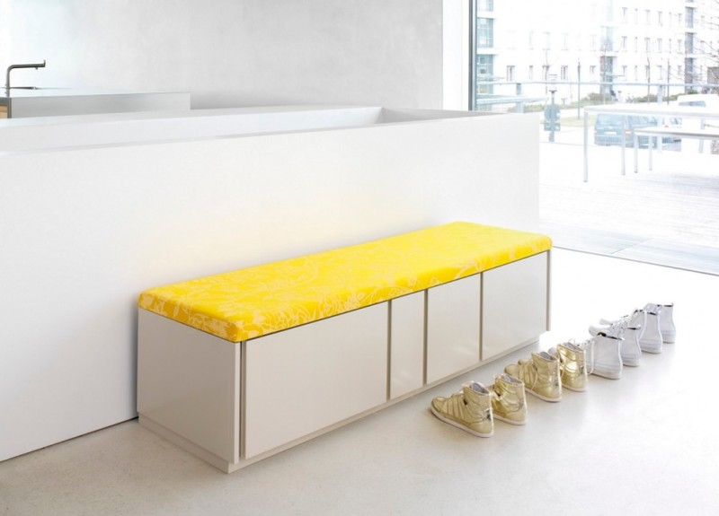 hallway with white cabinet with yellow embossed cushion