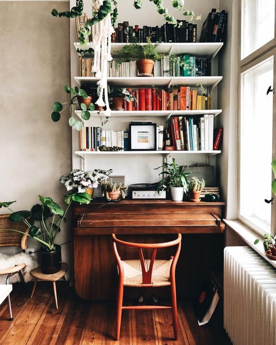 home office with dark wooden floor, dark wooden table with white wooden shelves in front