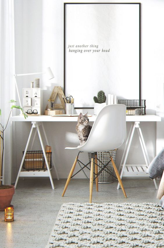 home office with grey floor, white wooden table, white mid century chair