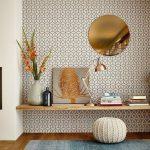 Home Office With Wooden Floor, Wooden Board Shelves As Table, White Rattan Ottoman, Patterned Wall, Golden Table Lamp