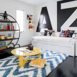 Kids Bedroom With Black Wooden Floor, White Stripped Blue Rug, Round Black Metal Shelves, White Bedding