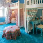 Kids Bedroom With Bold Blue Rug, Painting, Two Two Level Beddings With Bed In The Lvel Above, Study Area Under, Ottoman, Chandelier