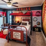 Kids Bedroom With Brown Rug, Black Wall With Baseball Wallpaper, Ball Ottoman, Glove Chair, Coffee Table With Bats Feet, Two Beds, Metal Bedding