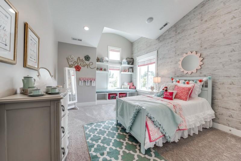 kids bedroom with grey rug, wallpaper, grey cabinet, shelves, mirror, green bedding