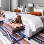 Kids Bedroom With Grey Wall, Striped Flooring, Two Plaid Beddings, Brown Stool