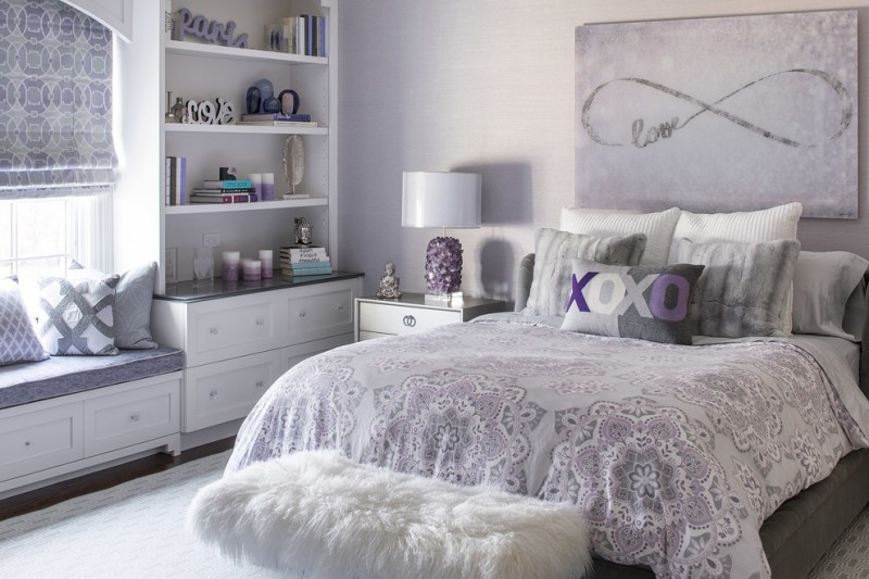 kids bedroom with white wall, white rug, sot purple bed linen, white rug bench, white wooden shelves, white bench with soft purple cushion, blind curtain