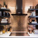 Kitchen With Black Cabinet With Golden Handles, White Marble Top, Golden Shiny Tiles Backsplash, Black Board Shelves