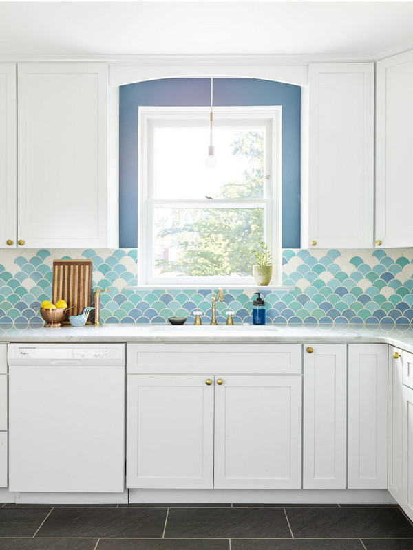 kitchen with black floor, white cabinet above and under, blue wall, blue ombre fish scale backsplash