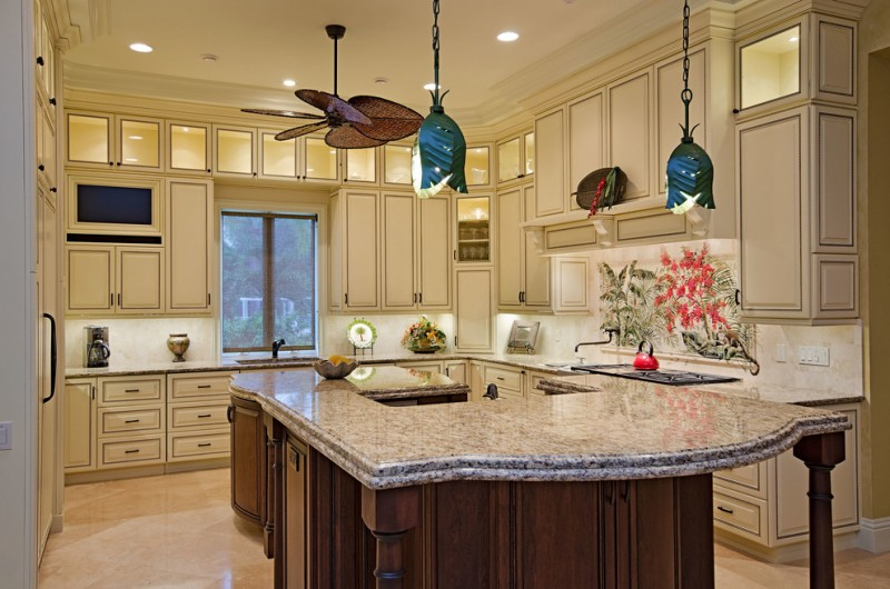 kitchen with brown marble top wooden island, white cabinets on top and floor, flower marble backsplash