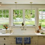 Light Over Kitchen Sink Hand Towel Holder White Framed Glass Windows Beige Cabinets White Marble Countertop