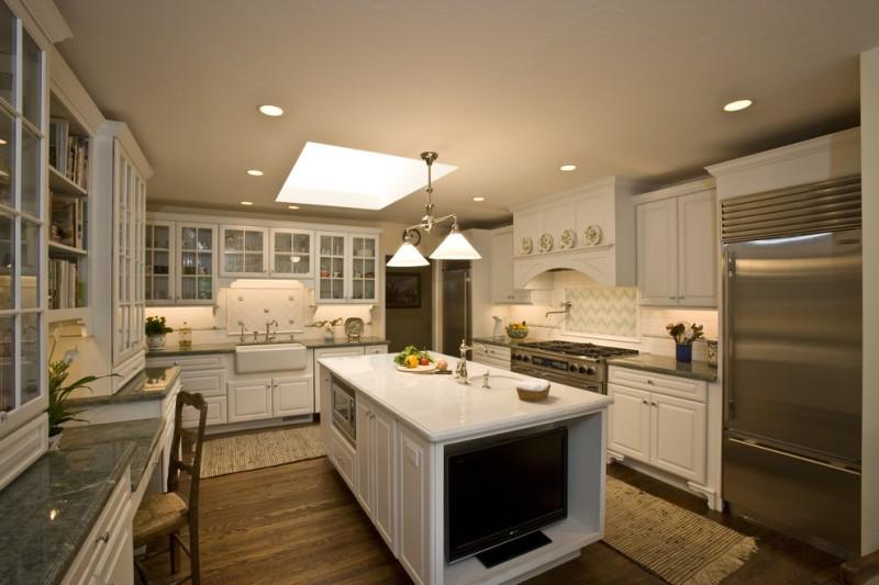 light over kitchen sink kitchen mats white cabinets white island wooden floor stove oven range hood backsplash microwave refrigerator
