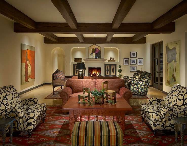 living room with brown tiles floor with red persian carpet, white with black ornamented patterned, red couch, flowery patterned couched, white painted wall,