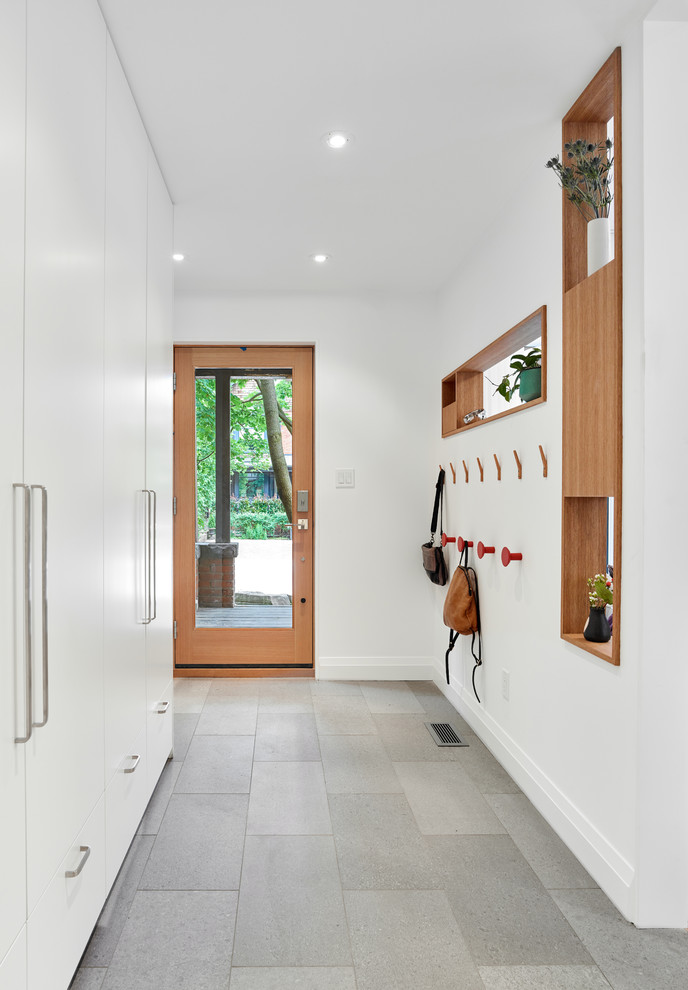 long hallway with grey marble floor, white painted wall, tall white cupboard, inbuilt wooden shelves, racks